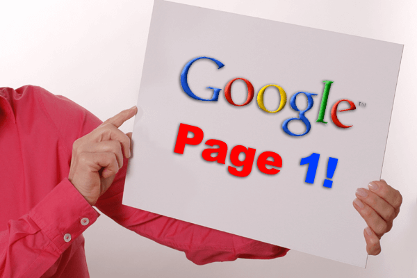 "woman's arm showing a large card sign with ""Google Page 1!"""