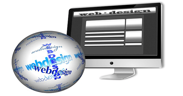 a black & white image of a monitor with Web Design on it with a baoll covered in webdesign in different fonts sitting in front of the monitor