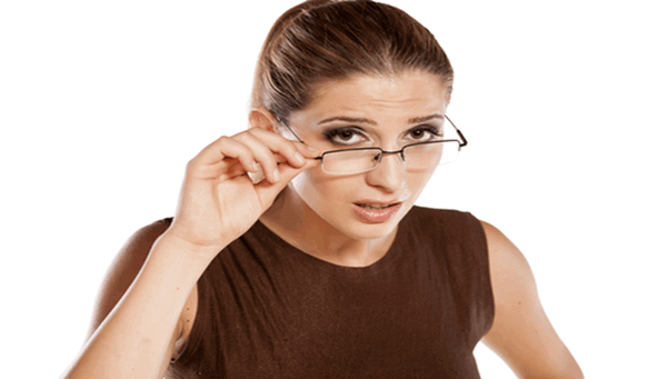 lady pulling down her glasses while looking quizzically at you