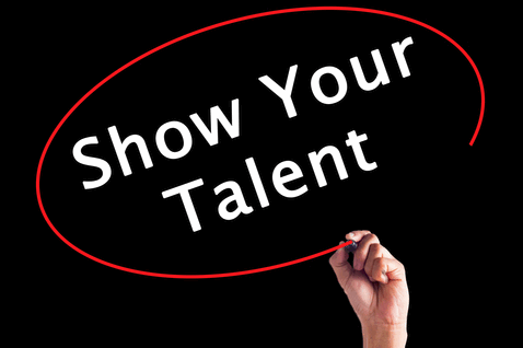 """a hand shown writing """"Show Your Talent"""" with a red circle around the words"""