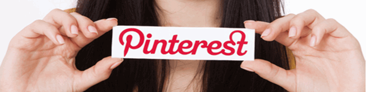 closeup of a lady holding a signe with Pinterest on it