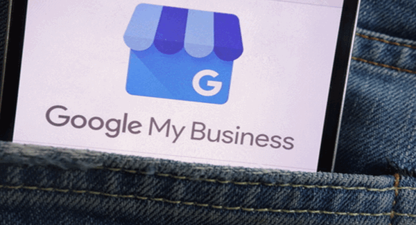 "image of someone's blue denium back pocket with a piece of paper with ""Google My Business"" printed on it"